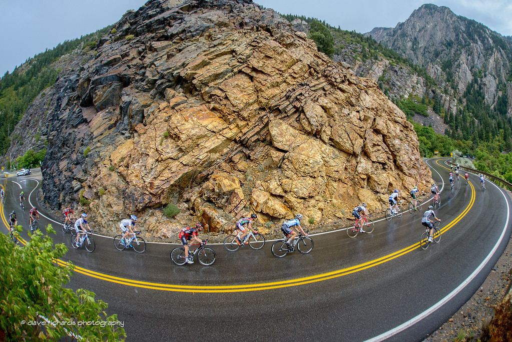 Superb bike handling skills on display as the riders negotiate a very tight turn in the rain near Storm Mountain while descending Big Cottonwood Canyon. Stage 6, 2016 Tour of Utah. Photo by Dave Richards, daverphoto.com