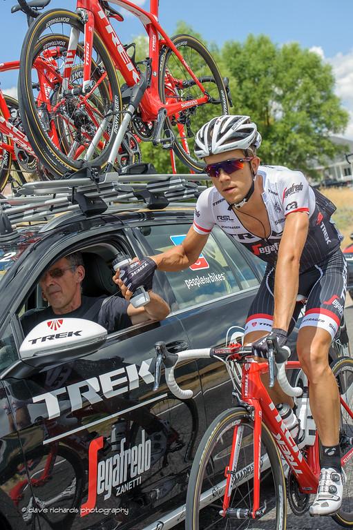 Sticky bottle handoff. Stage 6, 2016 Tour of Utah. Photo by Dave Richards, daverphoto.com