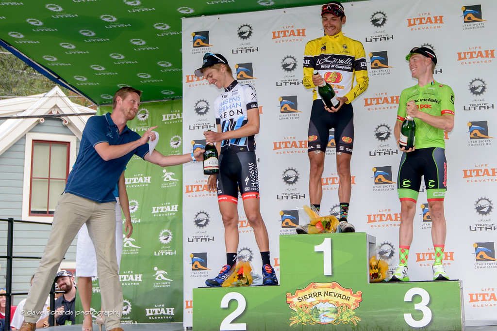 Race announcer Brad Sohner reminds Adrien Costa (Axeon Hagens Berman) that he's only 18 years old  and underage to be drinking a bottle of champagne here in the conservative state of Utah. Stage 7, 2016 Larry H. Miller Tour of Utah. Photo by Dave Richards, daverphoto.com