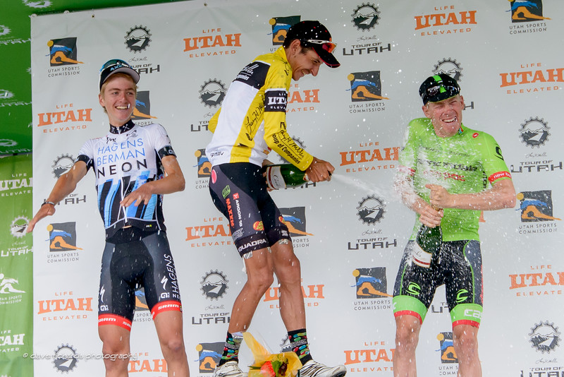 Lachlan Morton (Jelly Belly Maxxis) hoses down Andrew Talansky (Cannondale Drapac) as Adrien Costa (Axeon Hagens Berman) watches on while the champagne flys during the podium awards after Stage 7, 2016 Larry H. Miller Tour of Utah. Photo by Dave Richards, daverphoto.com