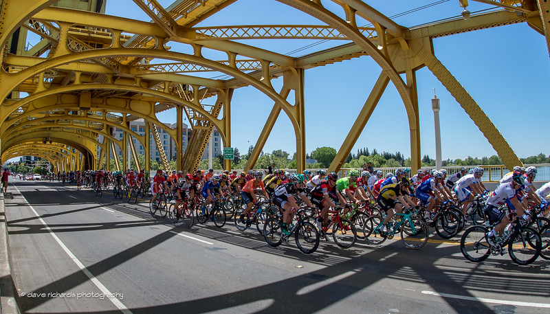 Riders roll out under the historic Tower Bridge in Sacramento for the start of Men's Stage 1,. 2017 Amgen Tour of California (Photo by Dave Richards, daverphoto.com)