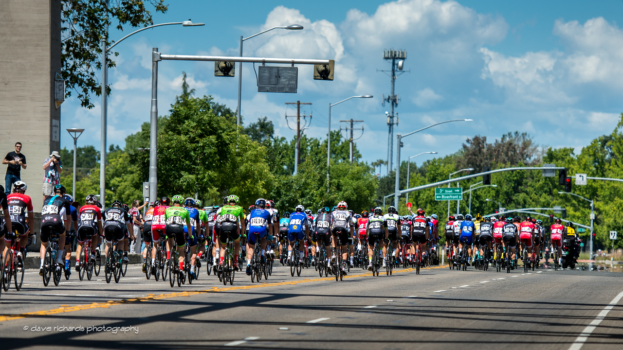 The peloton heads out on Stage 1 for an out and back loop from downtown Sacramento along the Sacramento River returning for a fast sprint finish next to the state Capitol grounds. 2017 Amgen Tour of California (Photo by Dave Richards, daverphoto.com)