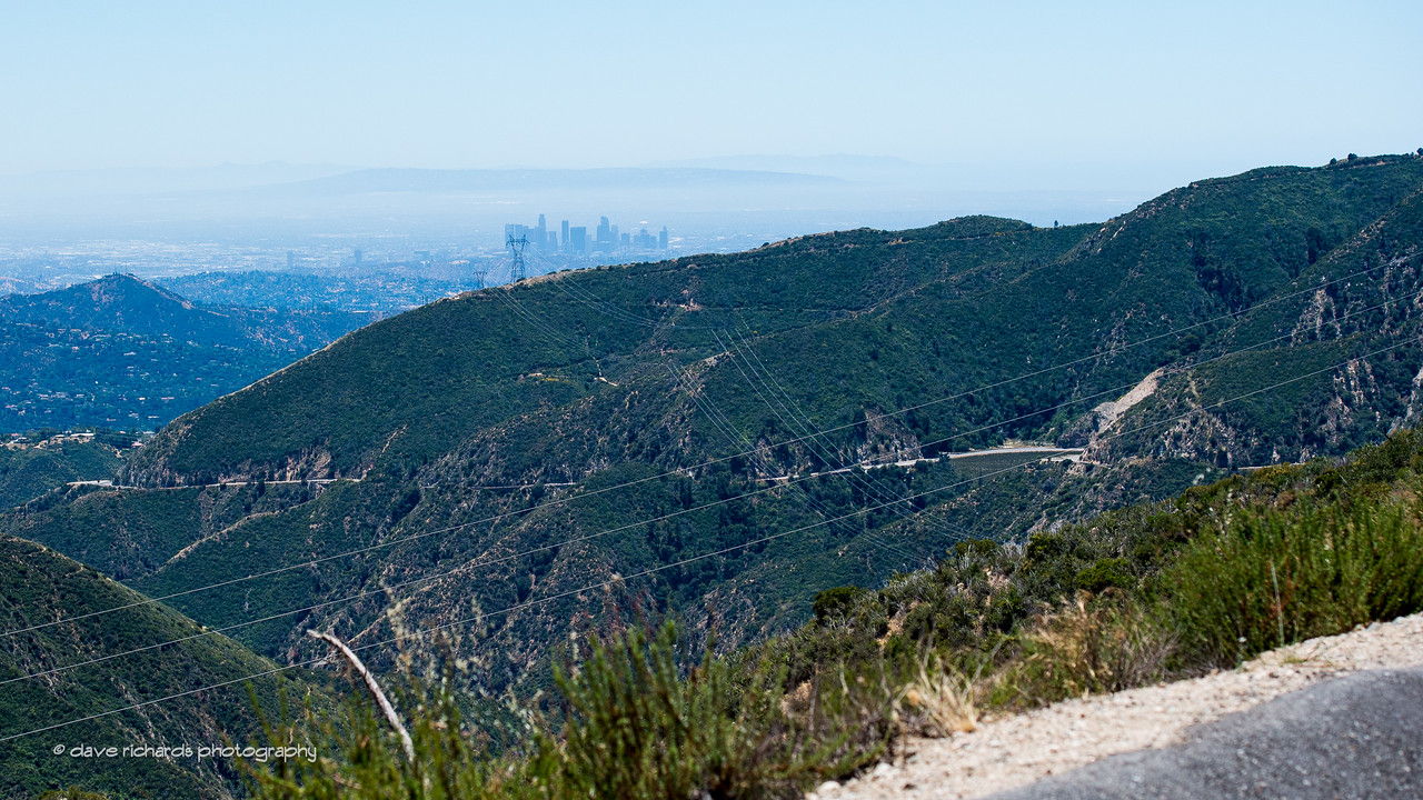 Downtown LA skyline in the distance as we start the descent down Angeles Crest Hwy. Men's Stage 7, 2017 Amgen Tour of California (Photo by Dave Richards, daverphoto.com)