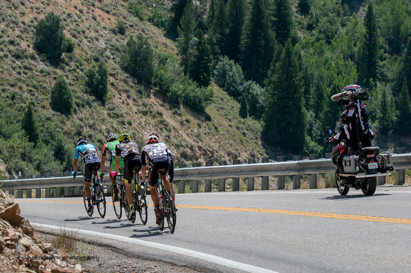 The TV moto keeps a close watch on the breakaway during Stage 1, Logan-BearLake-Logan,  2017 LHM Tour of Utah (Photo by Dave Richards, daverphoto.com)