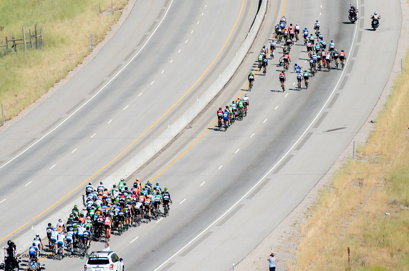 Riders touch wheels and tumble as the peloton breaks up on the cliimb to first KOM of the day on Stage 2, BrighamCity-SnowBasin,  2017 LHM Tour of Utah (Photo by Dave Richards, daverphoto.com)