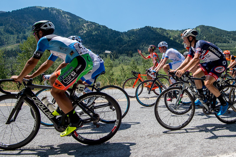 1K from the finish, water bottles are jettisoned by the riders. Stage 2, BrighamCity-SnowBasin,  2017 LHM Tour of Utah (Photo by Dave Richards, daverphoto.com)
