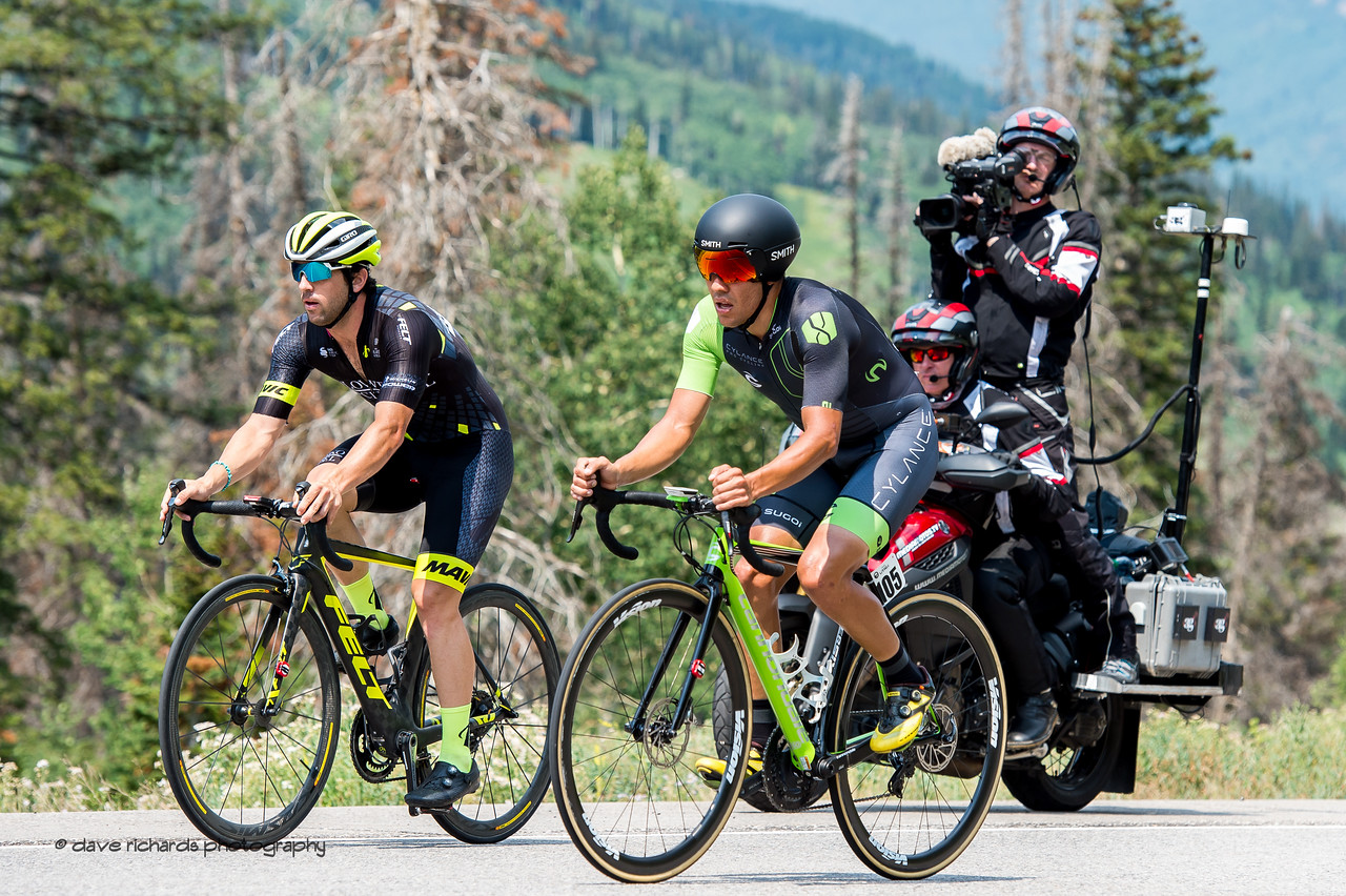 """Under the watcheful eye of the TV moto, a Cylance rider catches and passes his """"minute man"""" careful not to draft which is illegal during an individual time trial. Stage 3, Individual Time Trial Big Cottonwood Canyon,  2017 LHM Tour of Utah (Photo by Dave Richards, daverphoto.com)"""