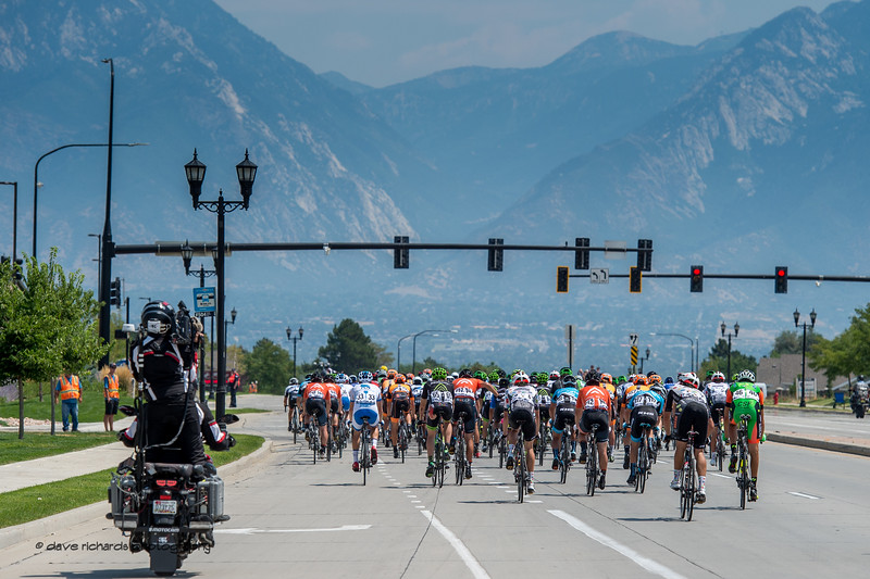 With the Wasatch Mountains as a backdrop, the peloton rolls in to South Jordan for the finish on  Stage 4, South Jordan City to west desert Pony Express Route and back,  2017 LHM Tour of Utah (Photo by Dave Richards, daverphoto.com)