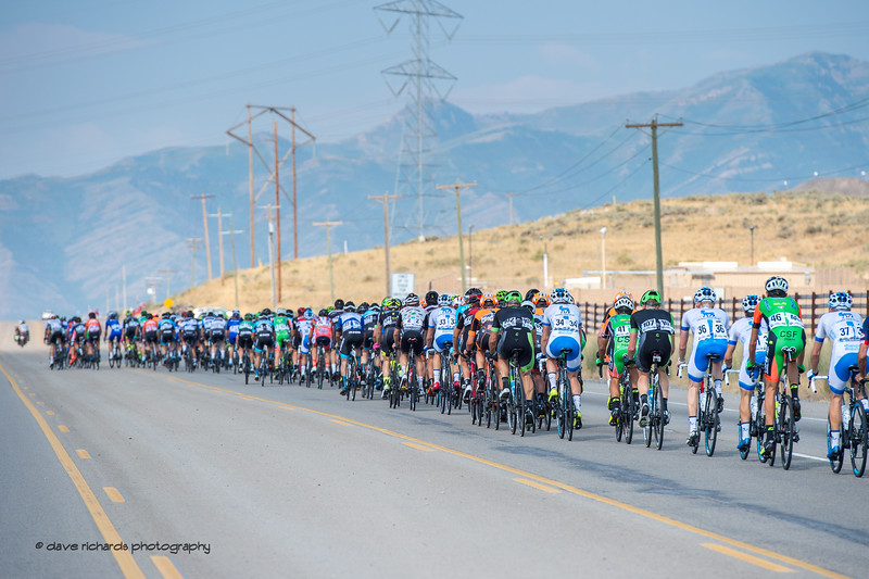 Massisve power poles line the road as the peloton heads out on Stage 4, South Jordan City to west desert Pony Express Route and back,  2017 LHM Tour of Utah (Photo by Dave Richards, daverphoto.com)