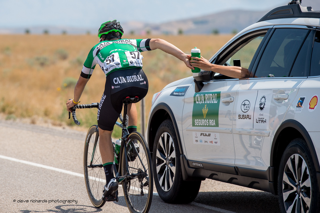 """""""Sticky"""" bottle handoff. Stage 4, South Jordan City to west desert Pony Express Route and back,  2017 LHM Tour of Utah (Photo by Dave Richards, daverphoto.com)"""