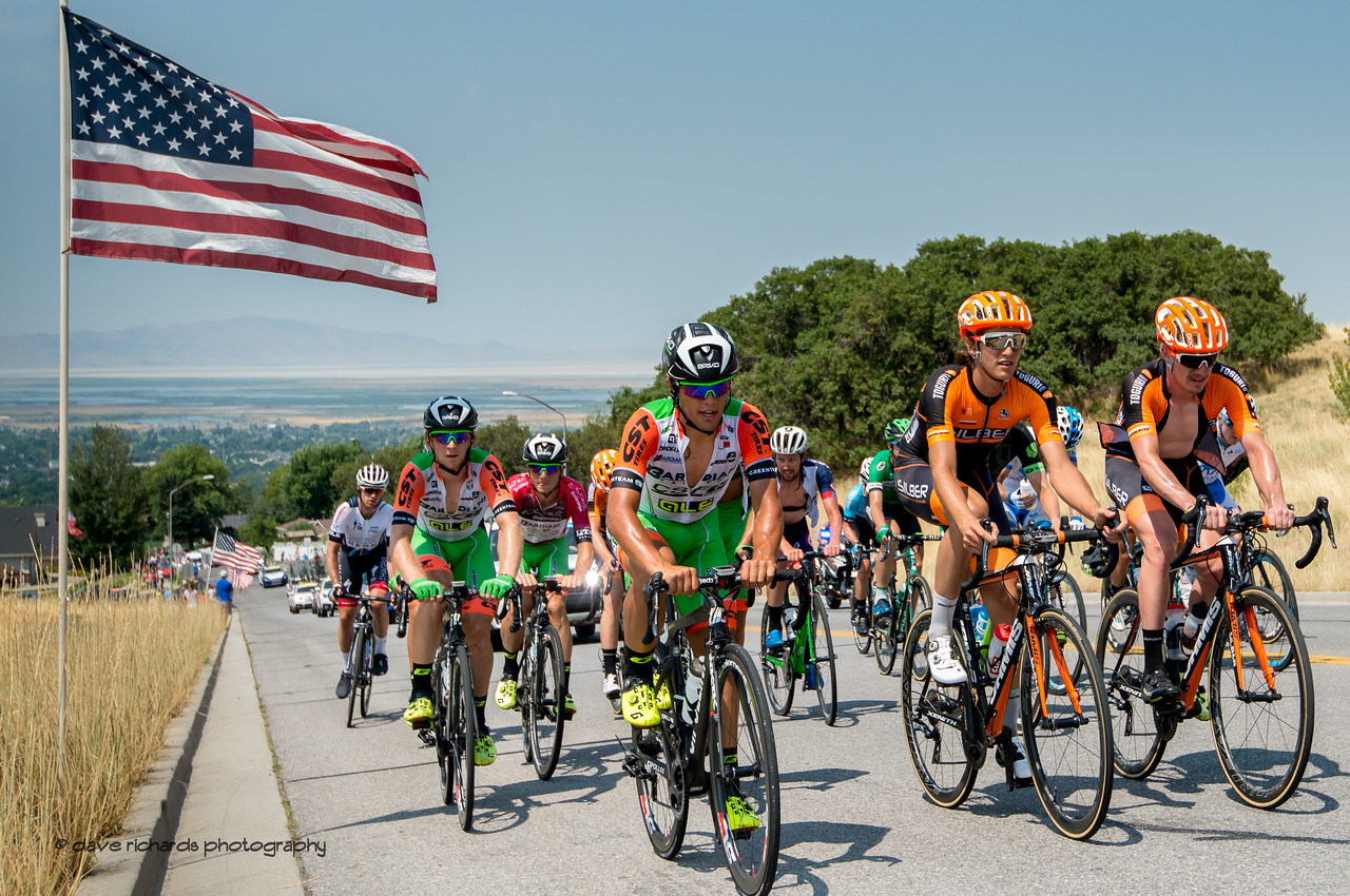 A group of exhausted riders pass under the American flag as they climb Bountiful Bench. Stage 5, Layton to Bountiful,  2017 LHM Tour of Utah (Photo by Dave Richards, daverphoto.com)