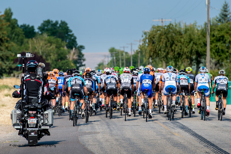 The peloton spreads out over narrow roads under the gaze of  the TV moto on Stage 5, Layton to Bountiful,  2017 LHM Tour of Utah (Photo by Dave Richards, daverphoto.com)