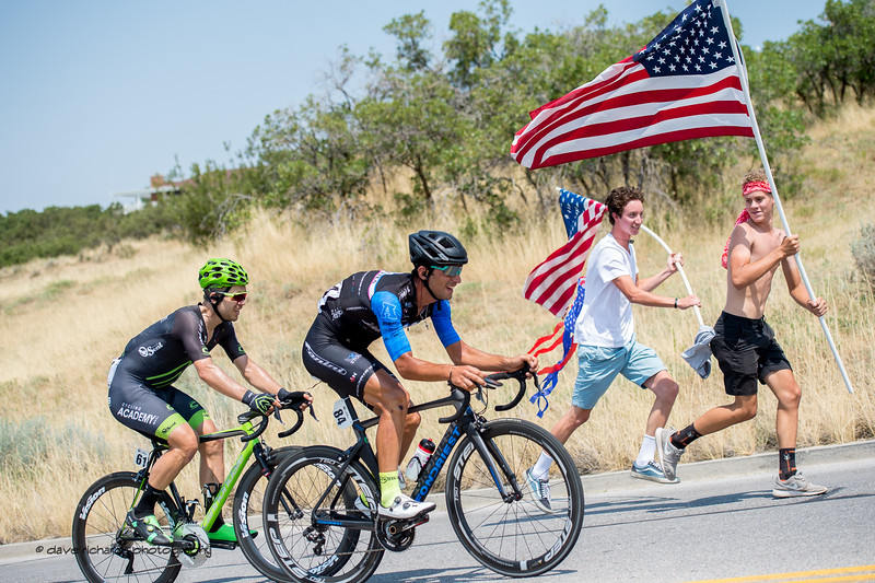 Enthusiastic flag bearers inspire the riders on the steep climb up Bountiful Bench. Stage 5, Layton to Bountiful,  2017 LHM Tour of Utah (Photo by Dave Richards, daverphoto.com)