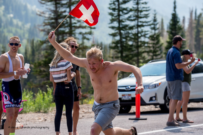 Swilss fan runs along the riders holding the national flag on Stage 6, Soldier Hollow  to Snowbird Ski Resort,  2017 LHM Tour of Utah (Photo by Dave Richards, daverphoto.com)