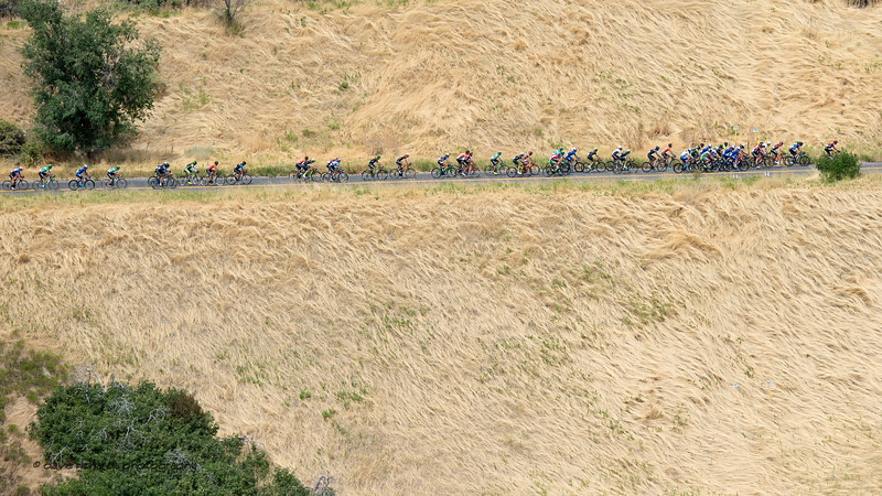 Wild grass fields encompass the riders as they  roll thru the neutral start above Memory Grove. Stage 7, Salt Lake City Circuit Race,  2017 LHM Tour of Utah (Photo by Dave Richards, daverphoto.com)
