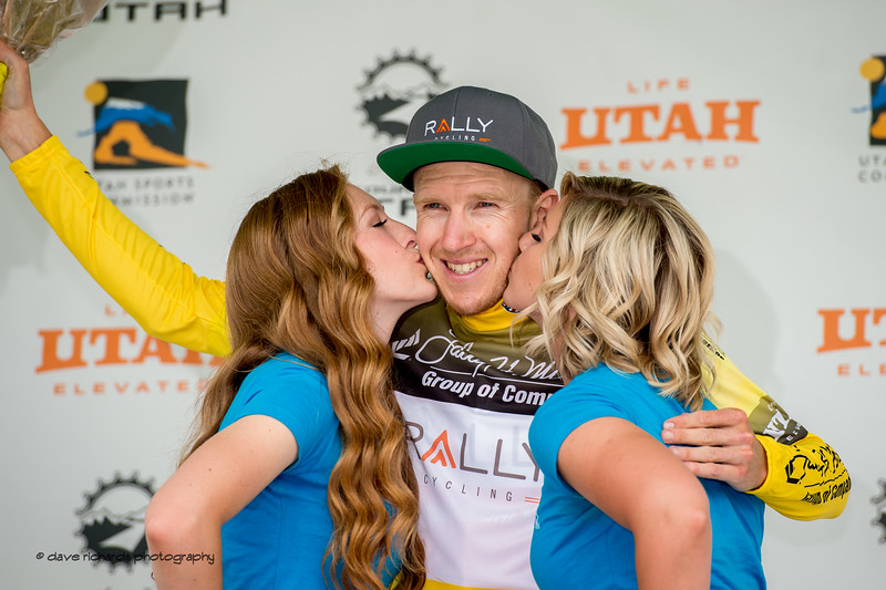 The victor (Rob Britton, Rally Cycling) gets the kisses from the podium hostesses after Stage 7, Salt Lake City Circuit Race,  2017 LHM Tour of Utah (Photo by Dave Richards, daverphoto.com)