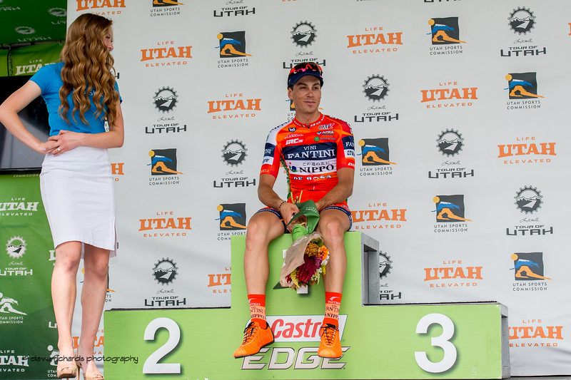 Marco Canola  (NIPPO - VINI FANTINI)  relaxes on the podium after winning Stage 7, Salt Lake City Circuit Race,  2017 LHM Tour of Utah (Photo by Dave Richards, daverphoto.com)