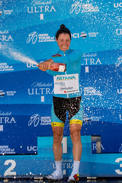 Astana rider gets her spray going on. Overall Awards, 2018 Amgen Tour of California cycling race (Photo by Dave Richards, daverphoto.com)