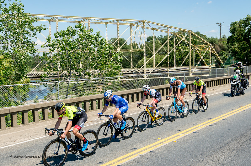 The breakaway passes by an old iron bridge. Men's Stage Five, Stockton to Elk Grove, 2018 Amgen Tour of California cycling race (Photo by Dave Richards, daverphoto.com)