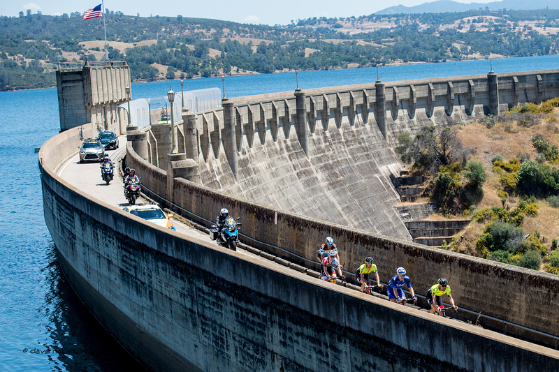 The breakaway rolls across the dam at Pardee Reservoir. Men's Stage Five, Stockton to Elk Grove, 2018 Amgen Tour of California cycling race (Photo by Dave Richards, daverphoto.com)