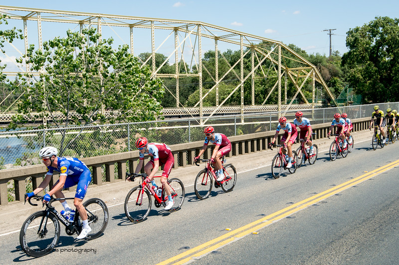 Peloton bridge crossing. Men's Stage Five, Stockton to Elk Grove, 2018 Amgen Tour of California cycling race (Photo by Dave Richards, daverphoto.com)