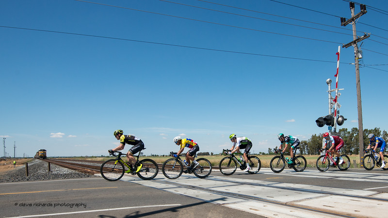 Peloton slips past the stopped train.. Men's Stage Five, Stockton to Elk Grove, 2018 Amgen Tour of California cycling race (Photo by Dave Richards, daverphoto.com)