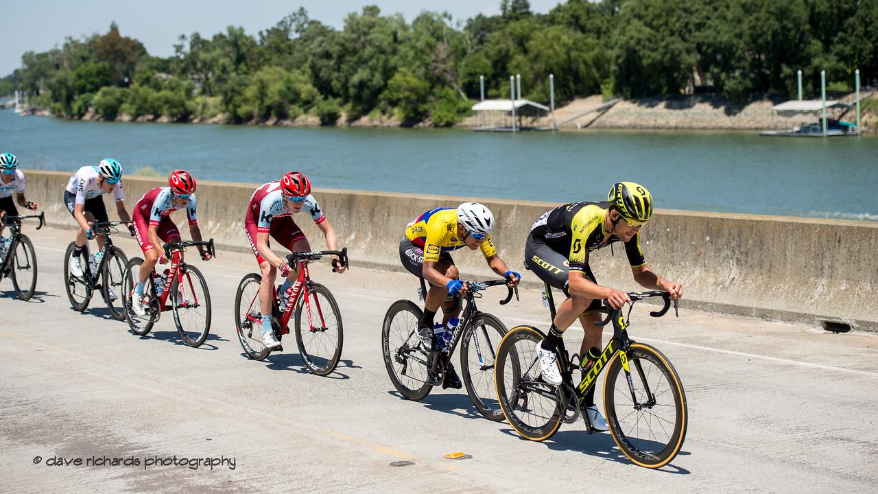 Mitchelton Scott rider guides the peloton along the Sacramento River. Men's Stage Seven, Sacramento, 2018 Amgen Tour of California cycling race (Photo by Dave Richards, daverphoto.com)