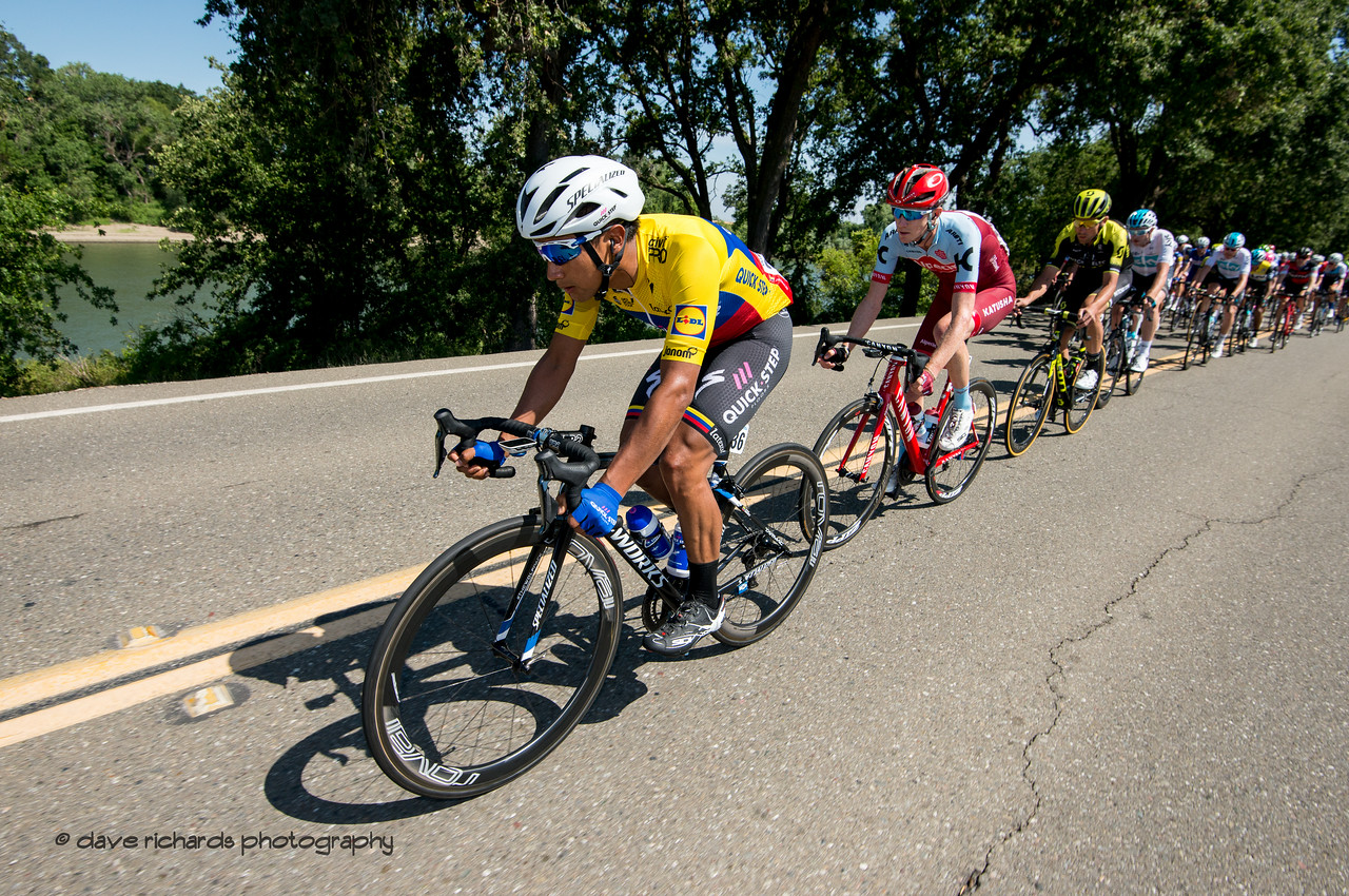 Egan Bernal  (Team Sky) ,yellow jersey leader, guides the peloton along the banks of the Sacramento River.  Men's Stage Seven, Sacramento, 2018 Amgen Tour of California cycling race (Photo by Dave Richards, daverphoto.com)
