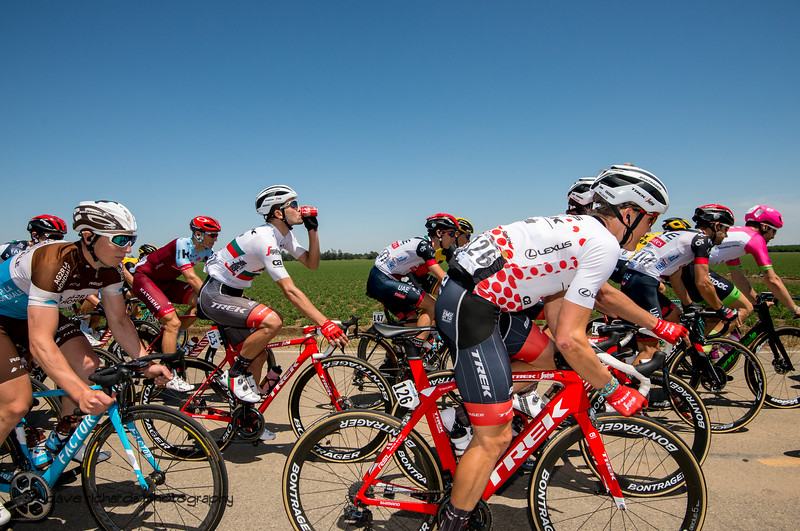 Coke seems to be the beverage of choice in the peloton. Men's Stage Seven, Sacramento, 2018 Amgen Tour of California cycling race (Photo by Dave Richards, daverphoto.com)