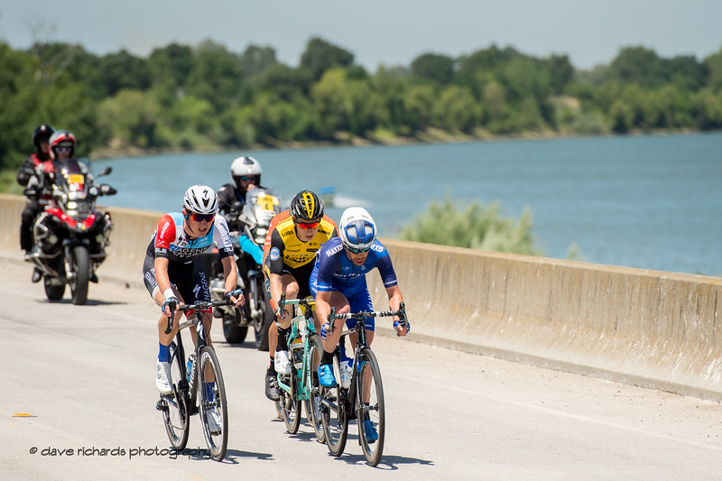 The breakaway is desperately fighting to stay out front ahead of the peloton.  Men's Stage Seven, Sacramento, 2018 Amgen Tour of California cycling race (Photo by Dave Richards, daverphoto.com)