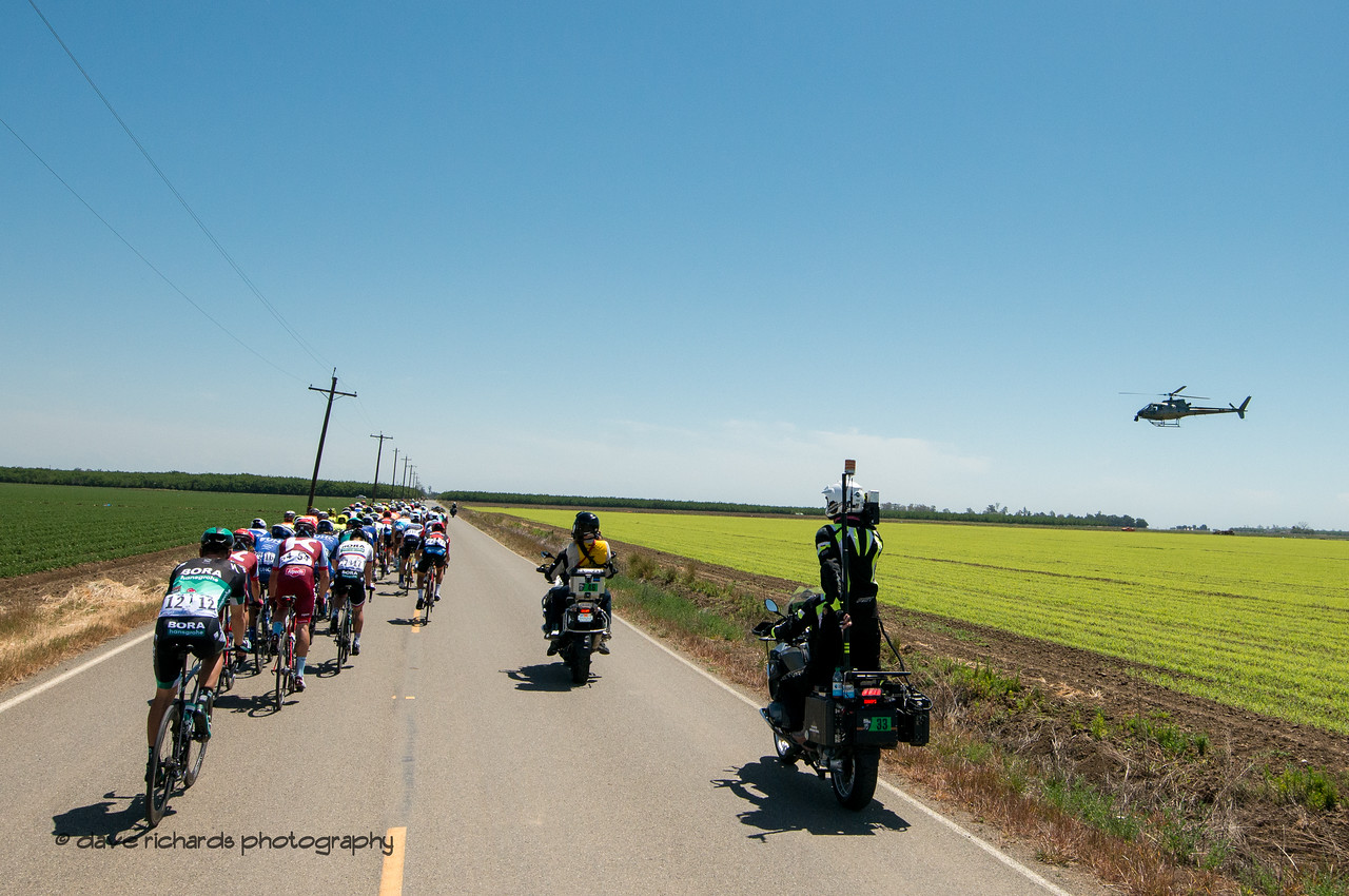 TV motorcycles and helicopter work in tandem to brings the sights and sounds of the race into your living room. Men's Stage Seven, Sacramento, 2018 Amgen Tour of California cycling race (Photo by Dave Richards, daverphoto.com)