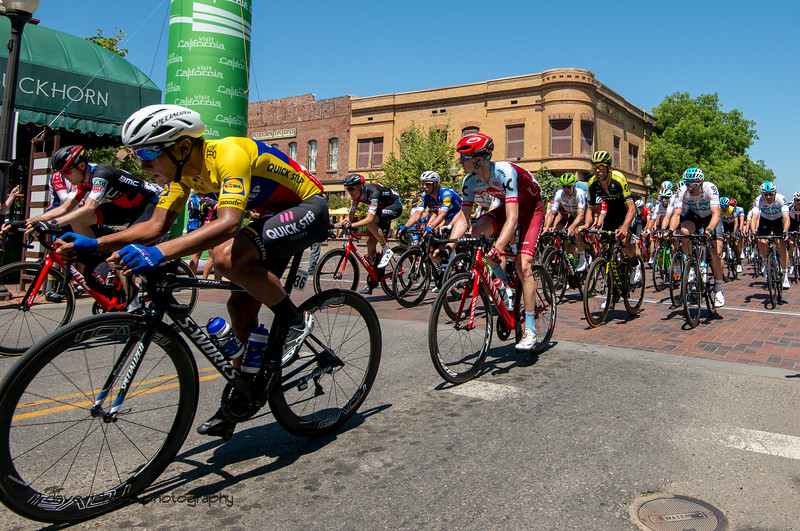 The peloton rides thru the picturesque town of Winters. Men's Stage Seven, Sacramento, 2018 Amgen Tour of California cycling race (Photo by Dave Richards, daverphoto.com)