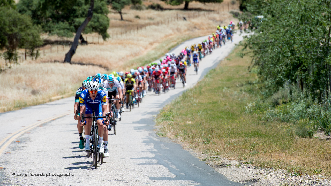 Team Quick-Step Floors leads the charge up a short hill. Men's Stage Three from King City to Laguna Seca Race Track, 2018 Amgen Tour of California cycling race (Photo by Dave Richards, daverphoto.com)