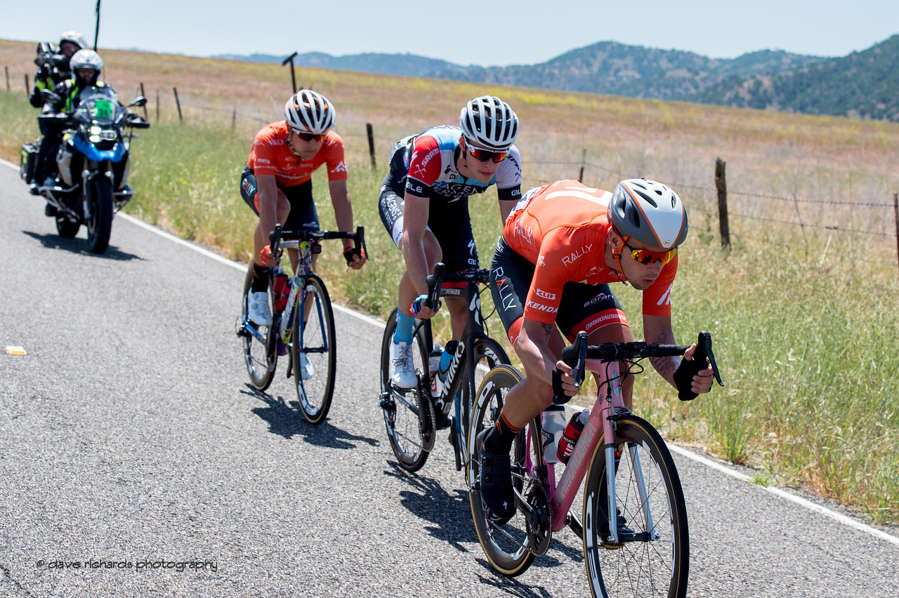 3 man breakaway working hard to stay away under the watchful eye of the TV moto. Men's Stage Three from King City to Laguna Seca Race Track, 2018 Amgen Tour of California cycling race (Photo by Dave Richards, daverphoto.com)