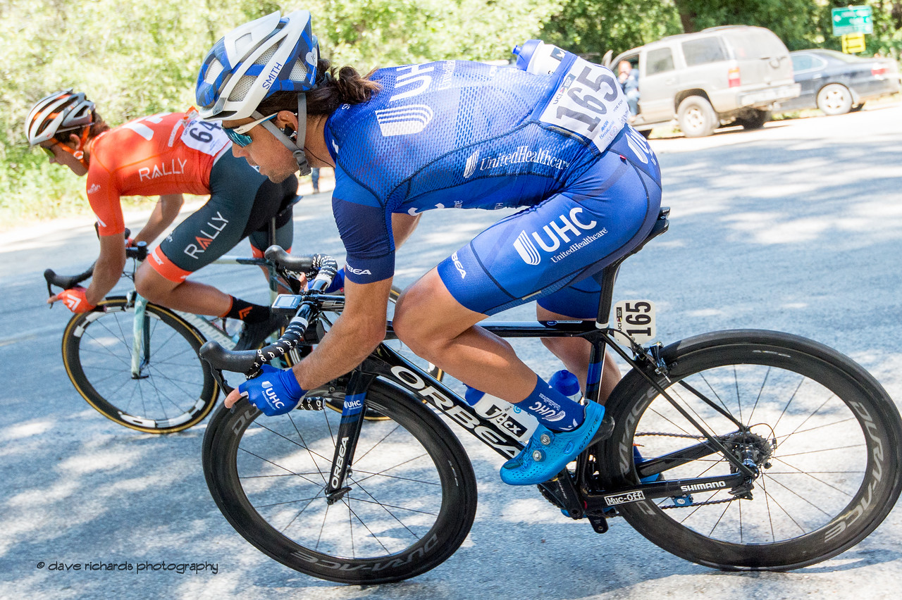 Adam DeVos (Rally) and Lachlan Norris (United Healthcare) nail a sharp curve at high speed on the descent into Carmel Valley. Men's Stage Three from King City to Laguna Seca Race Track, 2018 Amgen Tour of California cycling race (Photo by Dave Richards, daverphoto.com)