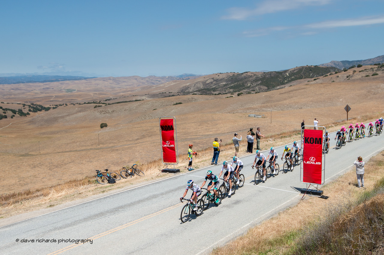 The peloton rolls thru the 1st KOM (King of the Mountains) of the day on King City Road.  Men's Stage Three from King City to Laguna Seca Race Track, 2018 Amgen Tour of California cycling race (Photo by Dave Richards, daverphoto.com)