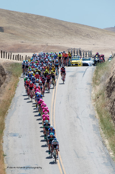 The peloton charges down a hill during Men's Stage Three from King City to Laguna Seca Race Track, 2018 Amgen Tour of California cycling race (Photo by Dave Richards, daverphoto.com)