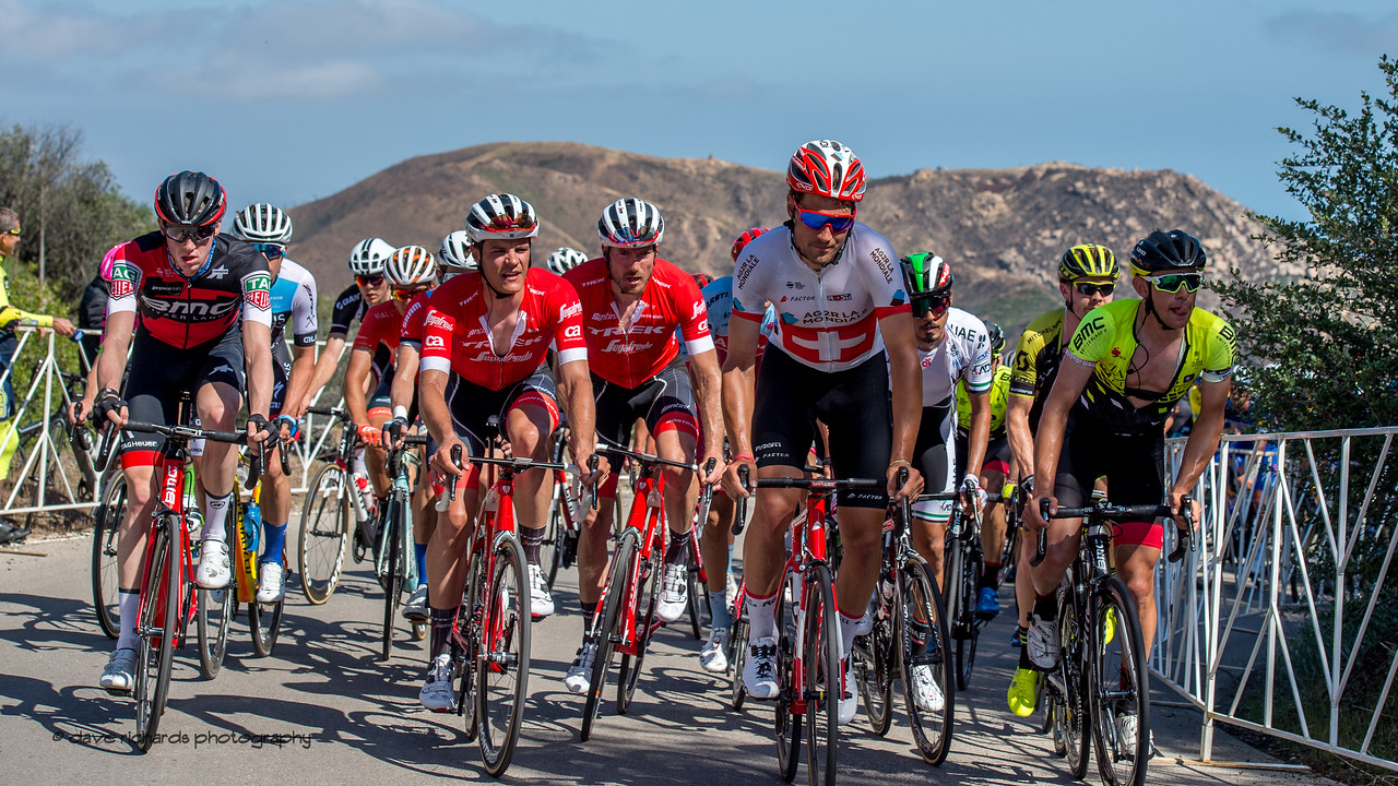 """The """"laughing group"""" arrives on the final meters of the Gibralter Road climb. Men's Stage Two from Ventura to Gibraltar Road, 2018 Amgen Tour of California cycling race (Photo by Dave Richards, daverphoto.com)"""