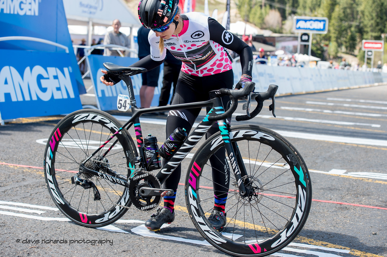Alexis Ryan (Canyon/SRAM) makes a final check of her bike before the start of Women's Stage Two, South Lake Tahoe, 2018 Amgen Tour of California cycling race (Photo by Dave Richards, daverphoto.com)