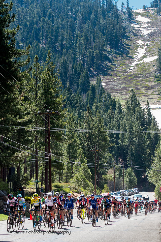 The last remaining snow overlooks the women as they roll out from Heavenly Valley Ski Resort for the start of  Women's Stage Two, South Lake Tahoe, 2018 Amgen Tour of California cycling race (Photo by Dave Richards, daverphoto.com)
