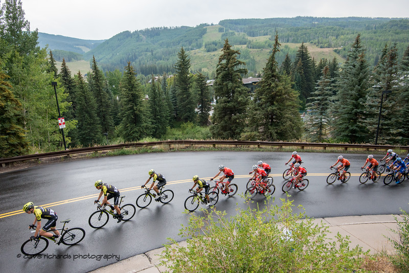 Ski runs of Vail Mountain form the backdrop as the peloton rolls up a short hill. Men's Stage 1 Vail Colorado, 2018 Colorado Classic cycling race (Photo by Dave Richards, daverphoto.com)