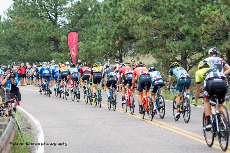 The peloton rolls through the Lookout Mtn. KOM.Men's Stage 3 road course starting in Denver running out west up Lookout Mtn, then Red Rocks with a loop back to Denver. 2018 Colorado Classic cycling race (Photo by Dave Richards, daverphoto.com)