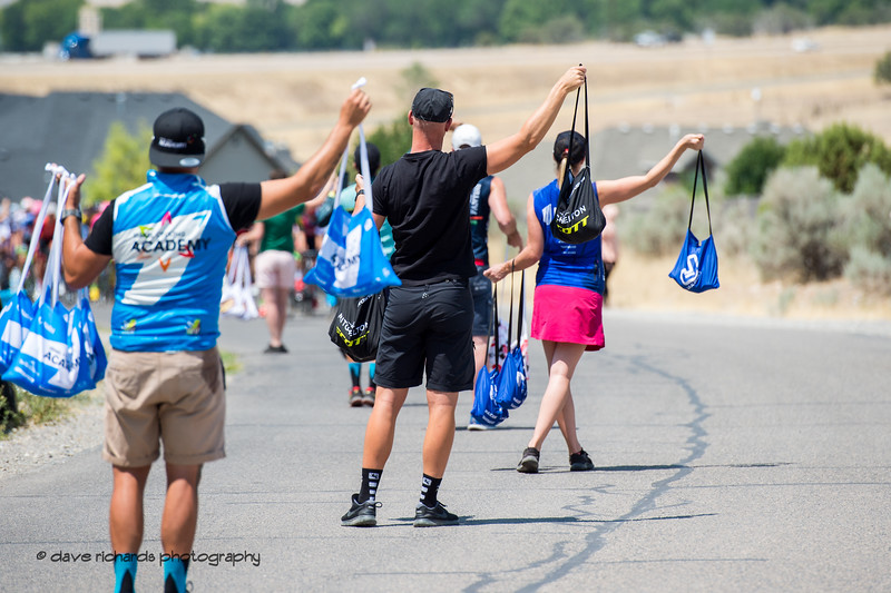 Soigneurs line up by the side of the road to hand out feedbags to the riders on Stage 2, 2018 LHM Tour of Utah cycling race (Photo by Dave Richards, daverphoto.com)