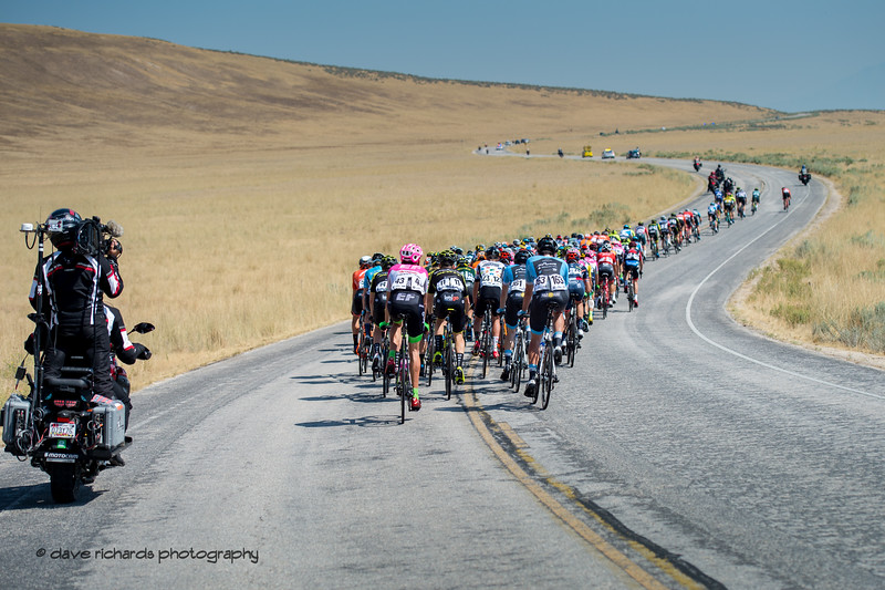 TV moto catches the action from behind as the peloton rides up  short hill on Antelope Island. Stage 3 Antelope Island to Layton, 2018 LHM Tour of Utah cycling race (Photo by Dave Richards, daverphoto.com)