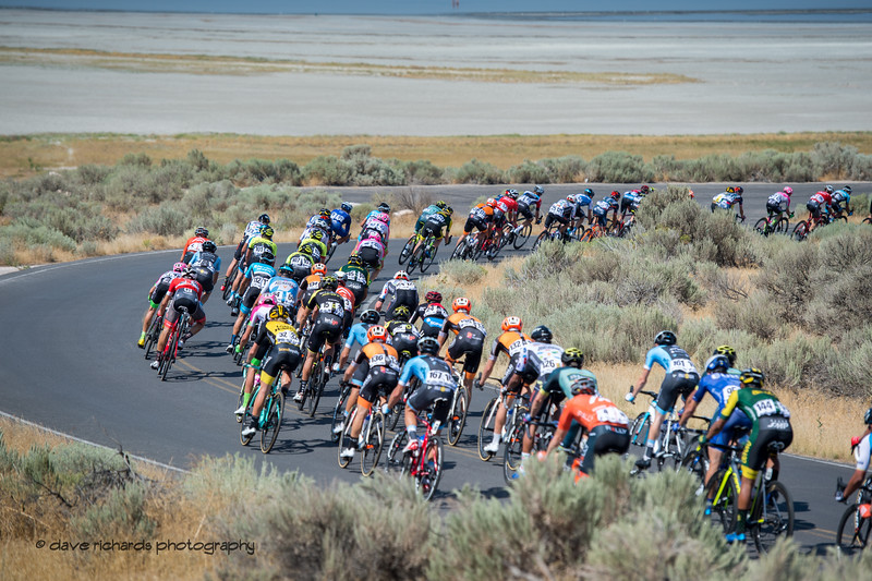 The road curves thru the sagebrush on Antelope Island. Stage 3 Antelope Island to Layton, 2018 LHM Tour of Utah cycling race (Photo by Dave Richards, daverphoto.com)