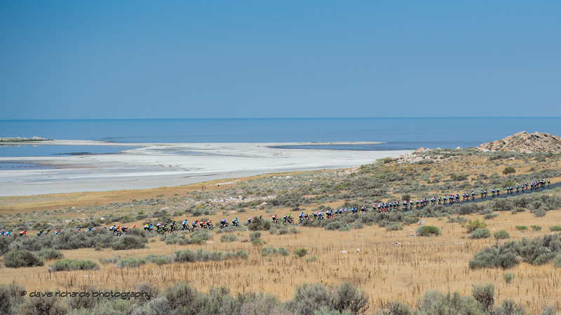 The Great Salt Lake forms the backdrop as the peloton stretches out on Antelope Island. Stage 3 Antelope Island to Layton, 2018 LHM Tour of Utah cycling race (Photo by Dave Richards, daverphoto.com)