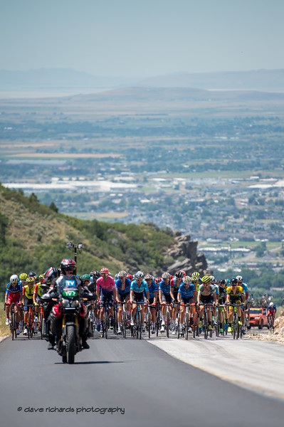 The peloton climbs high above the valley below on North Ogden Pass. Stage 2 - Brigham City to Powder Mountain Resort, 2019 LHM Tour of Utah (Photo by Dave Richards, daverphoto.com)