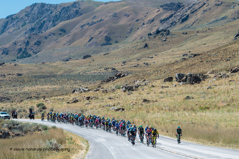 Rugged peaks overlook the riders as they traverse Antelope Island. Stage 3 - Antelope Island State Park to North Salt Lake City, 2019 LHM Tour of Utah (Photo by Dave Richards, daverphoto.com)