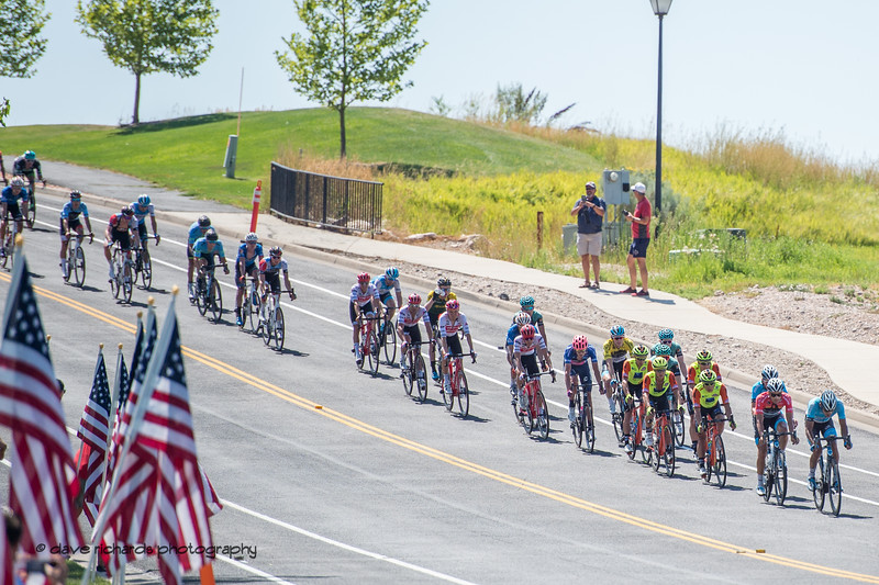 The peloton is chasing the break on the final circuits of Stage 3 - Antelope Island State Park to North Salt Lake City, 2019 LHM Tour of Utah (Photo by Dave Richards, daverphoto.com)