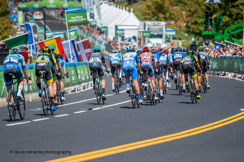 Riders approach the finish line starting the 1st of 3 final circuits on Stage 3 - Antelope Island State Park to North Salt Lake City, 2019 LHM Tour of Utah (Photo by Dave Richards, daverphoto.com)